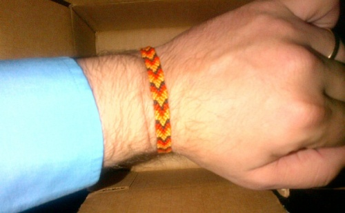 legendary friendship bracelet on a surprisingly hairy wrist